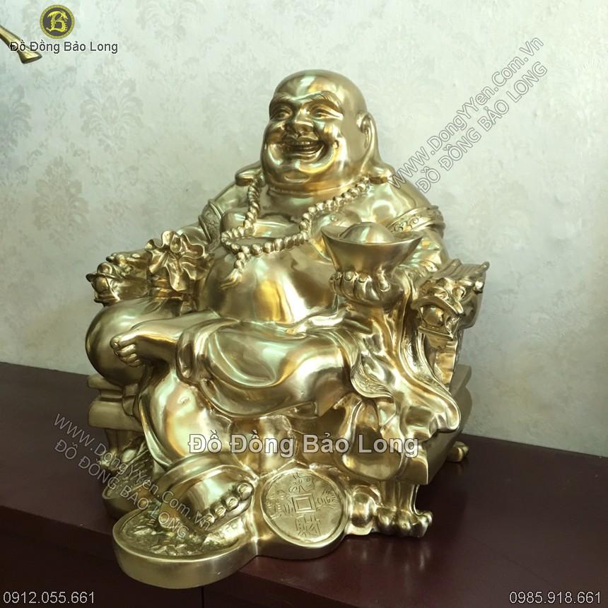 tượng di lặc cầm vàng và bao tiền miệng luôn cười hiền hậu