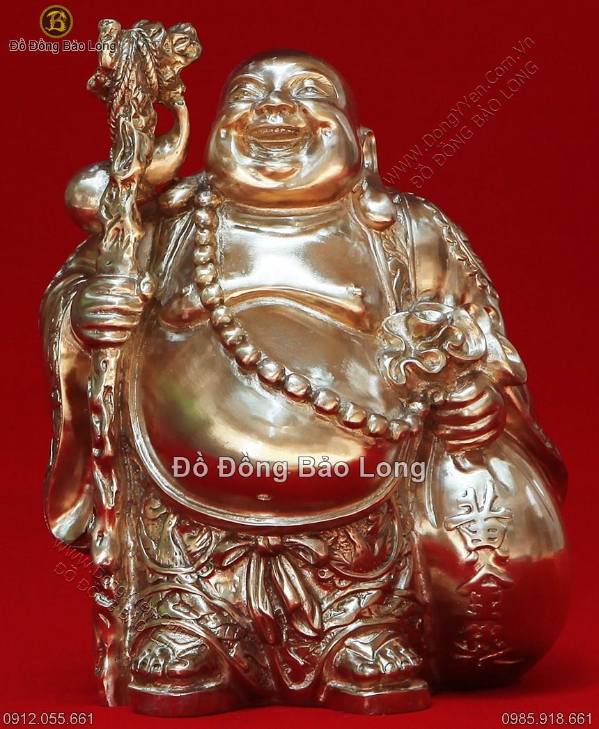 tượng phật di lặc cầm gậy và thỏi vàng cao 18cm